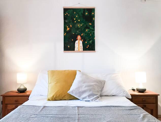 Bedroom with AC, ensuite bathroom, table, mirror...