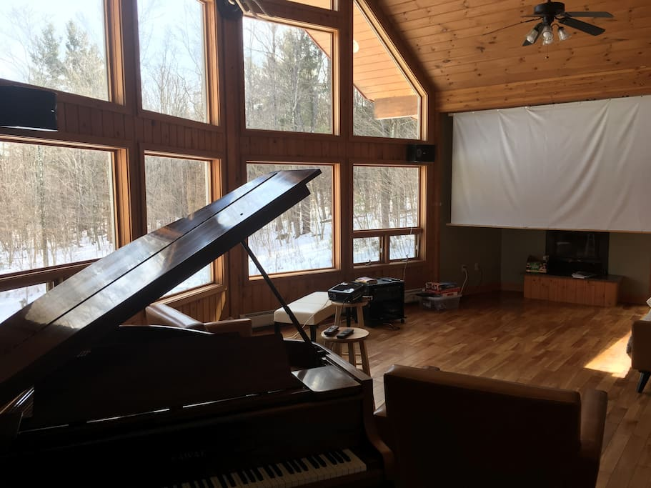Large Living Room with Baby grand and 128 in screen/projector
