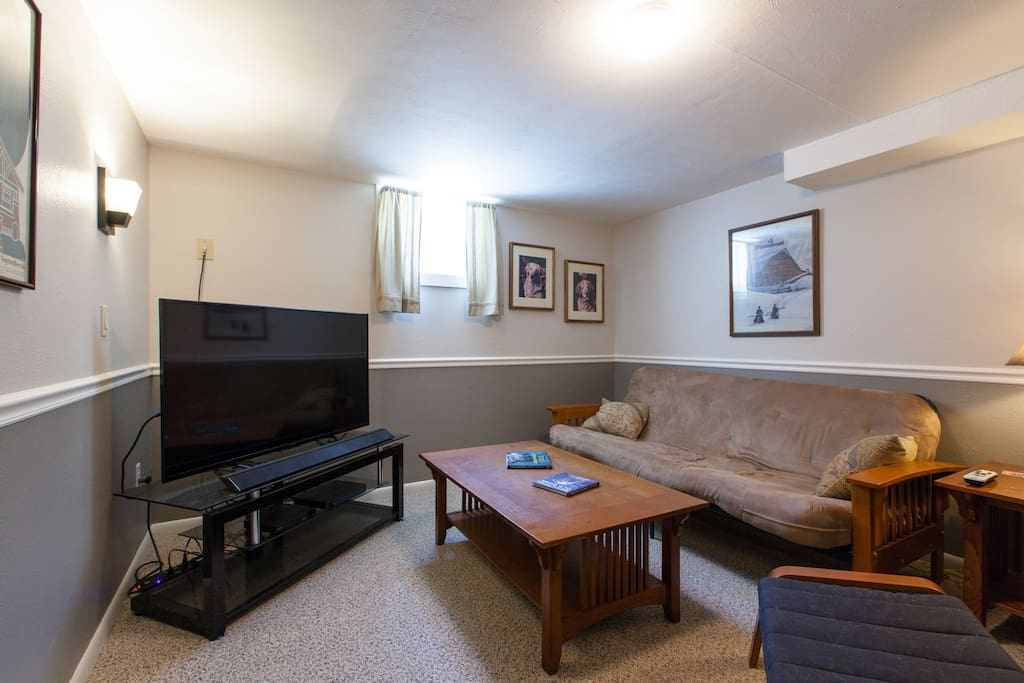 """Living area with 55"""" TV."""