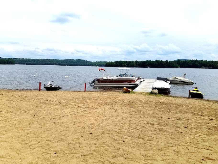 Private Lake Access, shared by the Homeowner's Association. 150 ft of sandy beach. Nice & gradual, great for swimming.