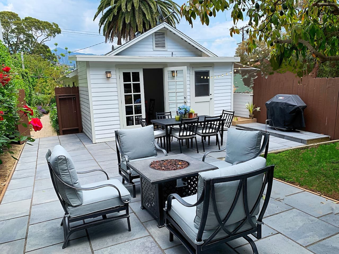 the back patio- with comfortable furniture and a gas grill