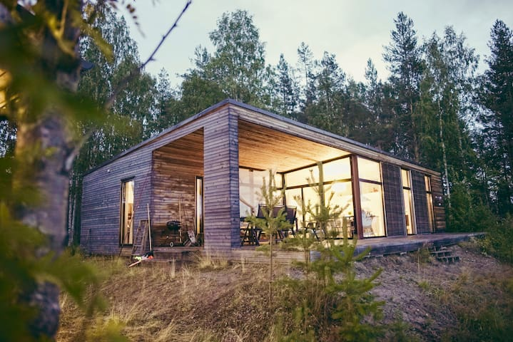 Modern river house, midnight sun, northern light!