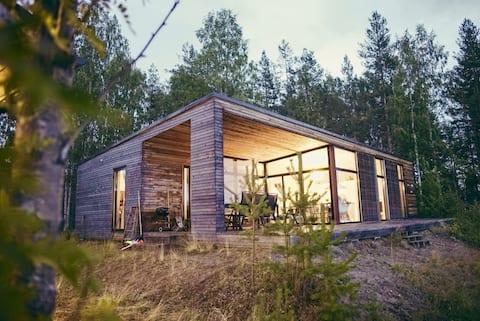Modern river house, midnight sun, northern light!