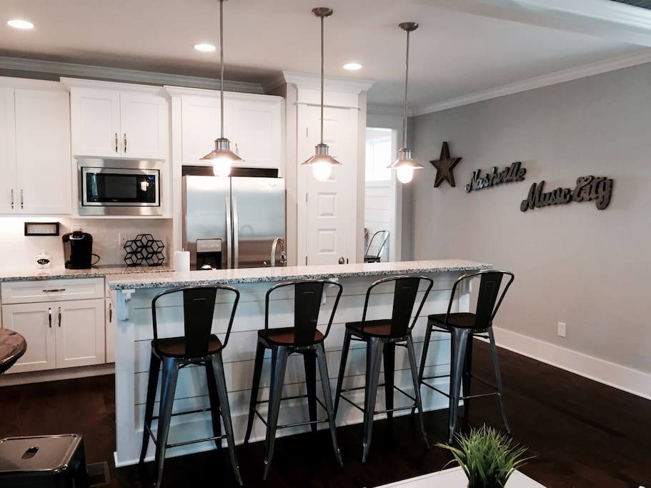Beautiful kitchen island with 4 tall stools, plenty of space!