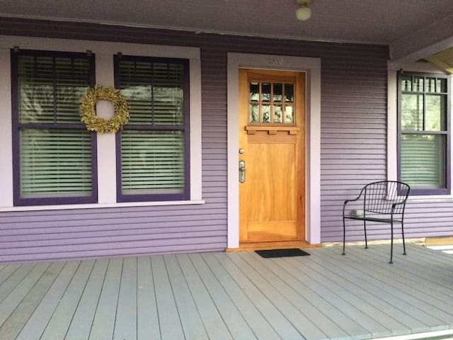 Front porch.  Still being restored.  Original front doors and windows restored by hand by Susanne and Sam.