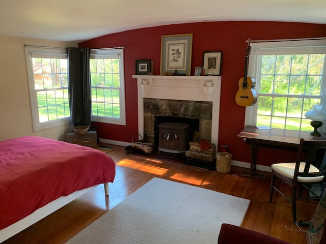 Master bedroom with Queen size bed and wood stove.