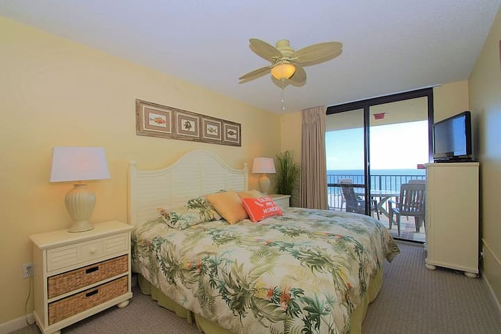 Master Bedroom with King Size Bed and Access to Balcony