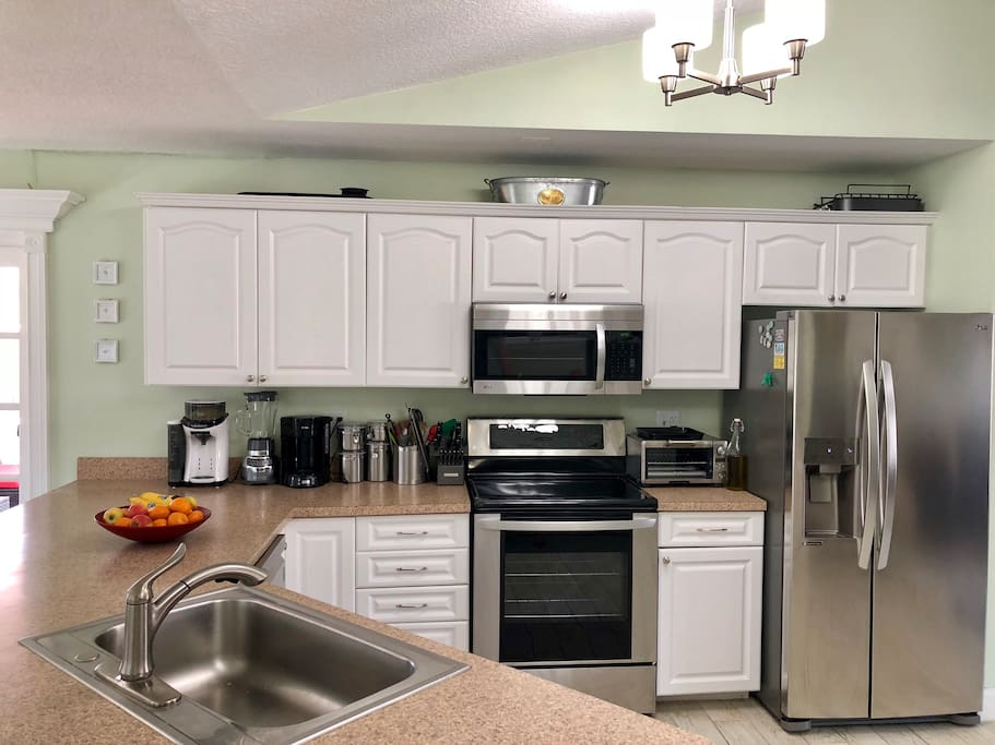 Kitchen. Brand new appliances. Fully stocked with pots/pans/dishes/silverware...