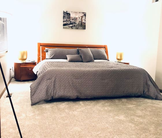 The coziest master bedroom boasting a King Sized bed, memory foam mattress, with a USB charging stations. Attached bathroom entrance.
