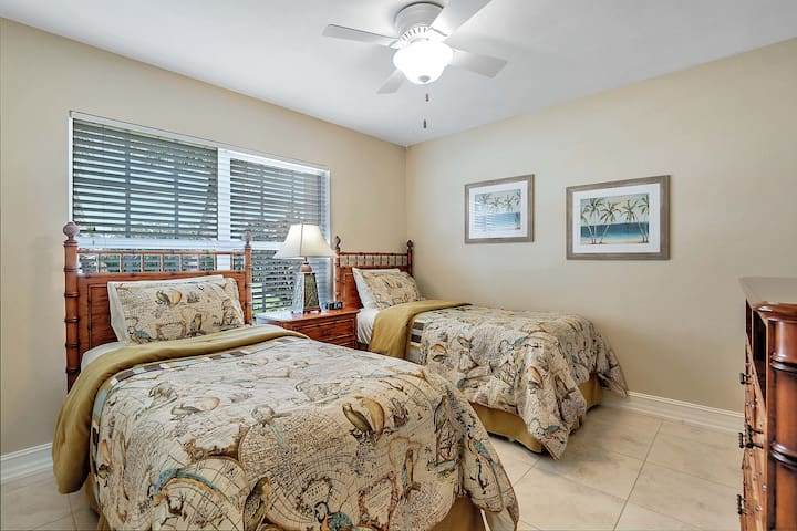 Second bedroom with two twin beds with a Smart TV to watch your favorite shows and apps.