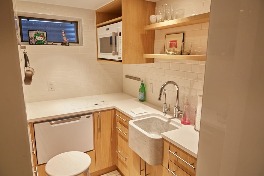 This compact kitchen offers top-of-the-line appliances and an eye-catching modern sink.