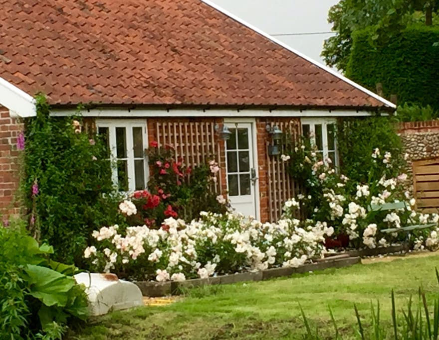 another shot of the rose garden and the Old Stables front door