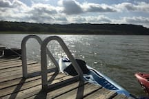 The dock has a swim ladder and sits across the lake from the beautiful hills of the Texas Hill Country.