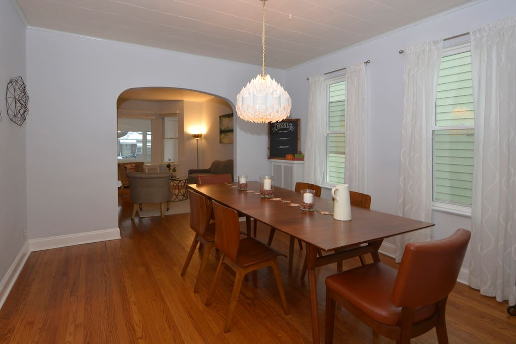 The semi-enclosed dining room is the warm and inviting heart of our home