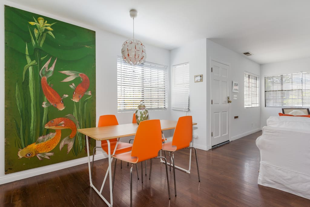 Bright and sunny dining area with original artwork