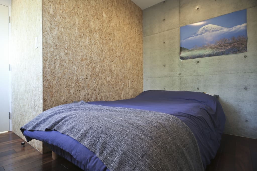 a semi-double sized bed in a separate bed room