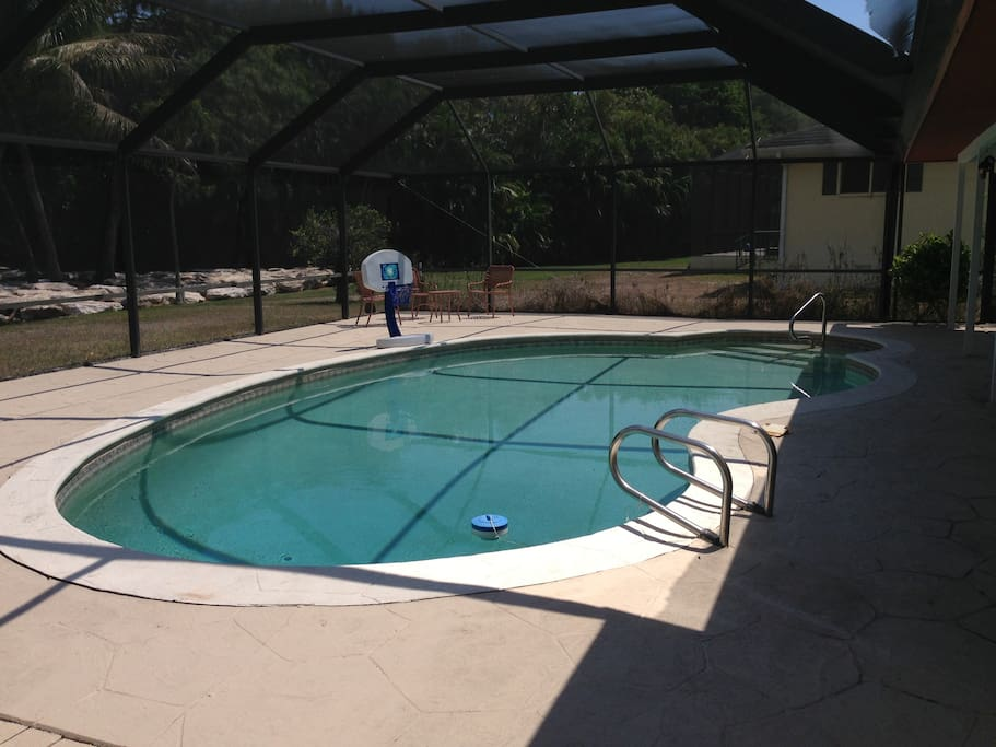 Pool in the lanai, overlooking the golf course.