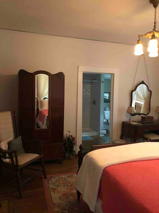 Spacious room and  private bathroom with large shower,  toilet and vanity on main level of house.