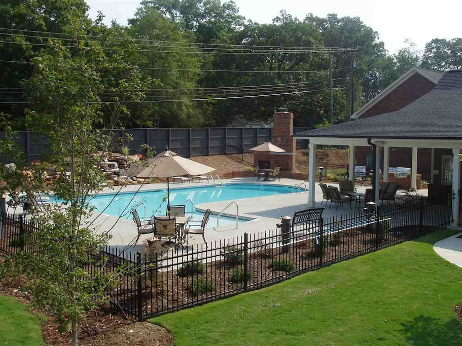 This is the community pool it also has a grill and fireplace. The poolhouse has a full kitchen and bathrooms, this is where you will find your internet and cable. The code to access is 0209.