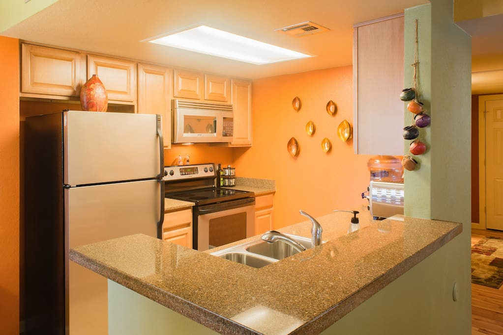 Kitchen features granite counter-tops, and a glass cook-top range.