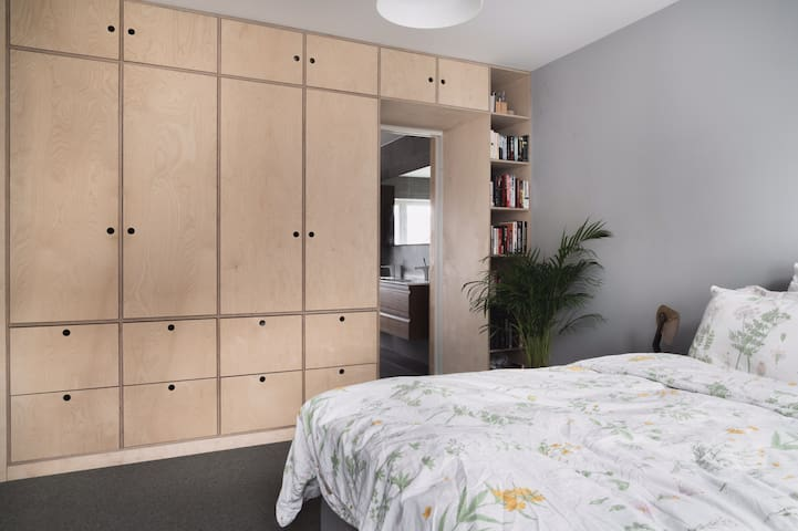 Bedroom 1. The bedroom with a double bed has a lot of room for storage. All the bedrooms have merino wool carpet floors that gives you that luxurious hotel room feeling
