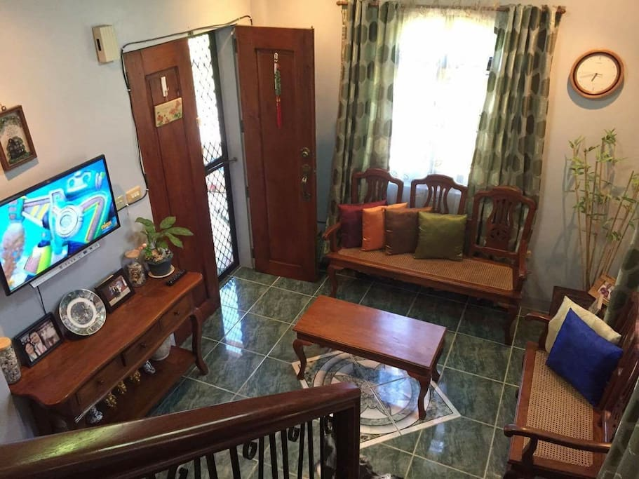Downstairs living room, with flat screen TV and antique furnitures