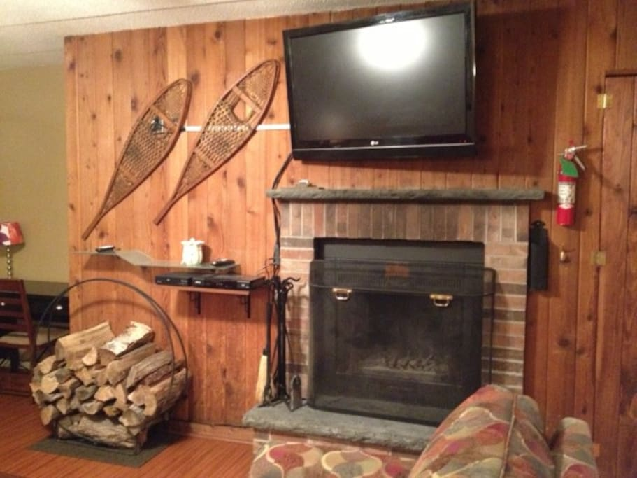 Working fireplace with free wood & hi-def TV