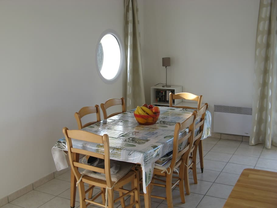Dining area with table that seats 6 - 8 and chairs.