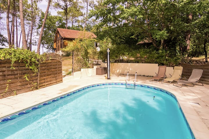 Chalet located In a wooded area with private pool.