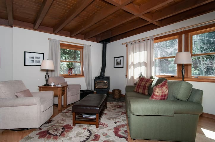 comfortable and cozy living room - wood burning stove and oak hardwood floors add to the warmth of this lovely room