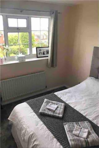 Garden view bedroom with double bed