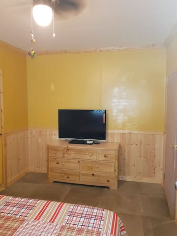 This room comes with a tv with a descrambler.
