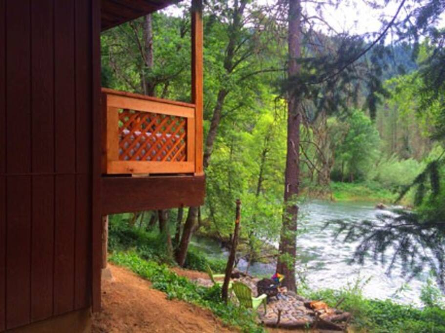 The covered river porch has steel cable rail on the river side for great views!