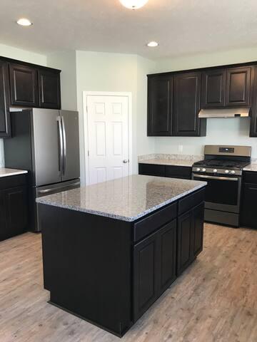 Luxurious NEW construction! Large open floor plan