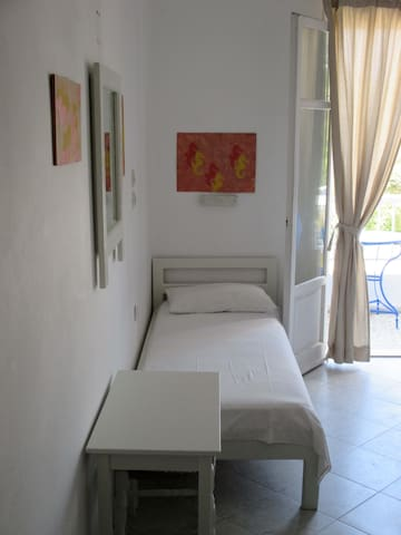 Room with a balcony.  1 single + 1 double bed.  To see videos of the rooms, please try you tube hotel parko channel.