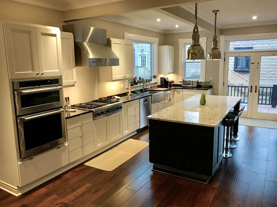 Help yourself to our gourmet kitchen equipped with top of the line appliances (Viking, Kitchen Aid, etc.)  Enjoy breakfast at our kitchen island.
