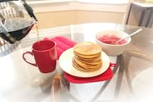 Wake up to homemade Vegan/GF banana pancakes with fruit sauce. (available upon request when host is home; self-serve when not home).