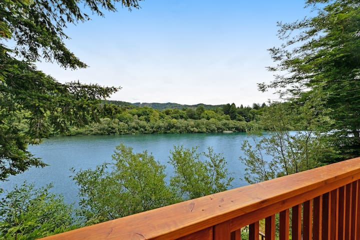 NEW LISTING! Lovely riverfront home w/ wraparound deck, fireplace & river access