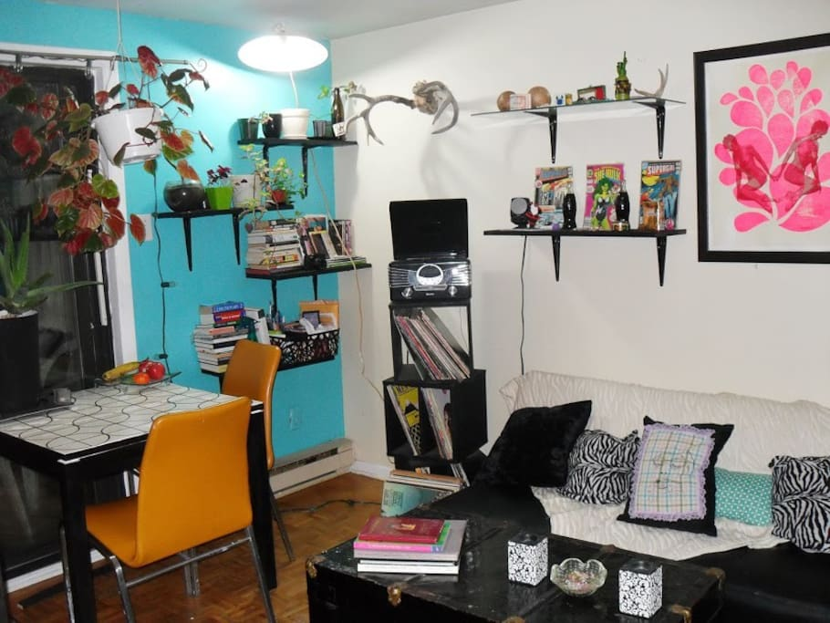 Living room -  Has fold-out couch, electric fireplace, books (including guidebooks), shoe rack, plants and seating for 6