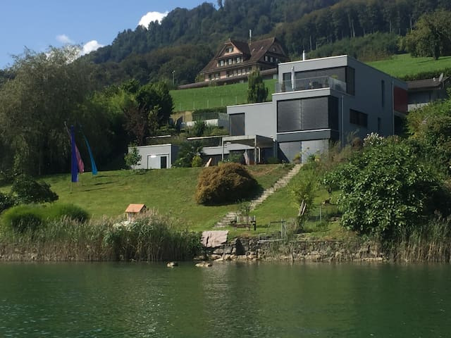 Summer: Villa Wilen taken from Lake Sarnen