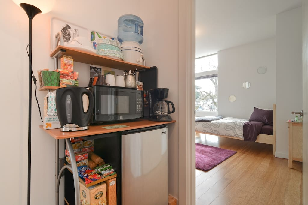 Fully stocked kitchenette steps from your room on your dedicated floor! Free coffee, tea, and snacks! Filtered water, coffee pot, hot water maker, microwave, refrigerator, and plenty of dishes. You'll feel right at home!
