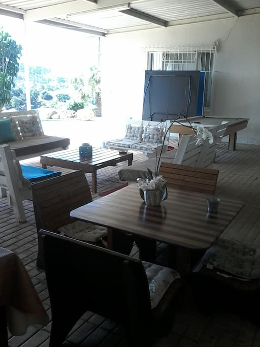 Outside leisure lounge with table tennis, pool table and jacuzzi as well a swimming pool