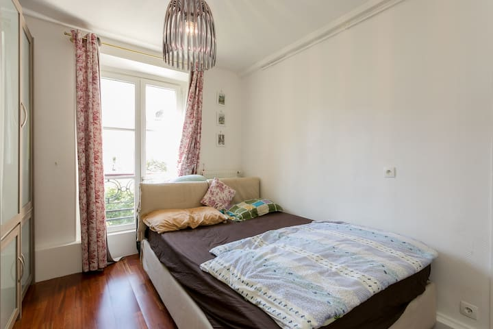 The cozy room with a huge french styled window