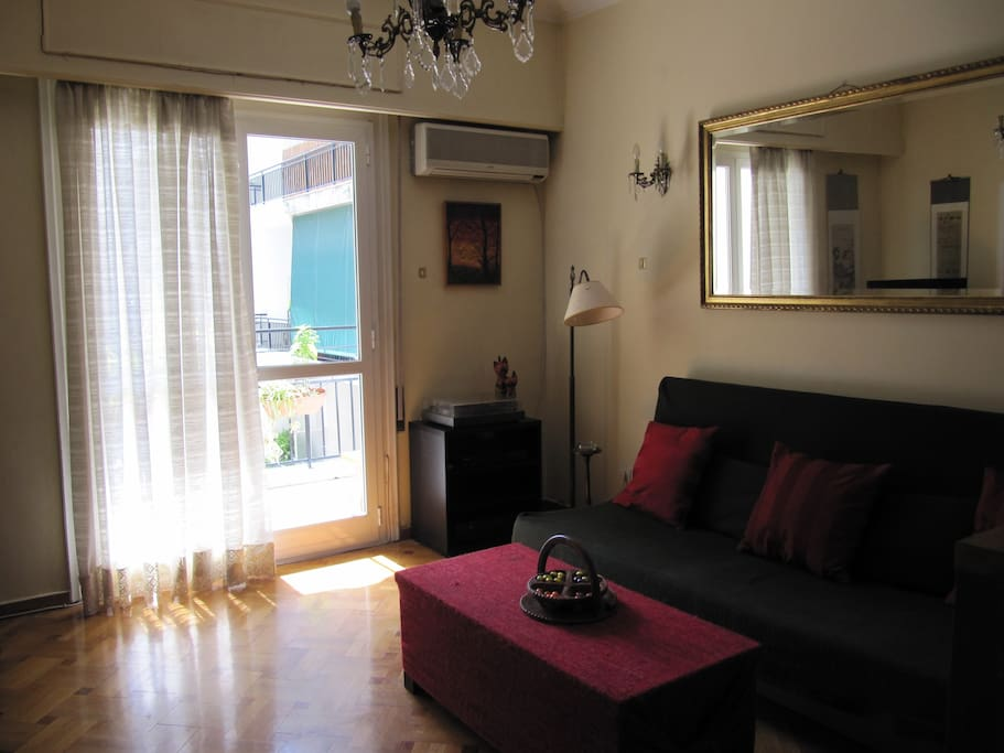 living room, right side. The sofa turns into a double bed. Includes LED tv and air-conditioner.