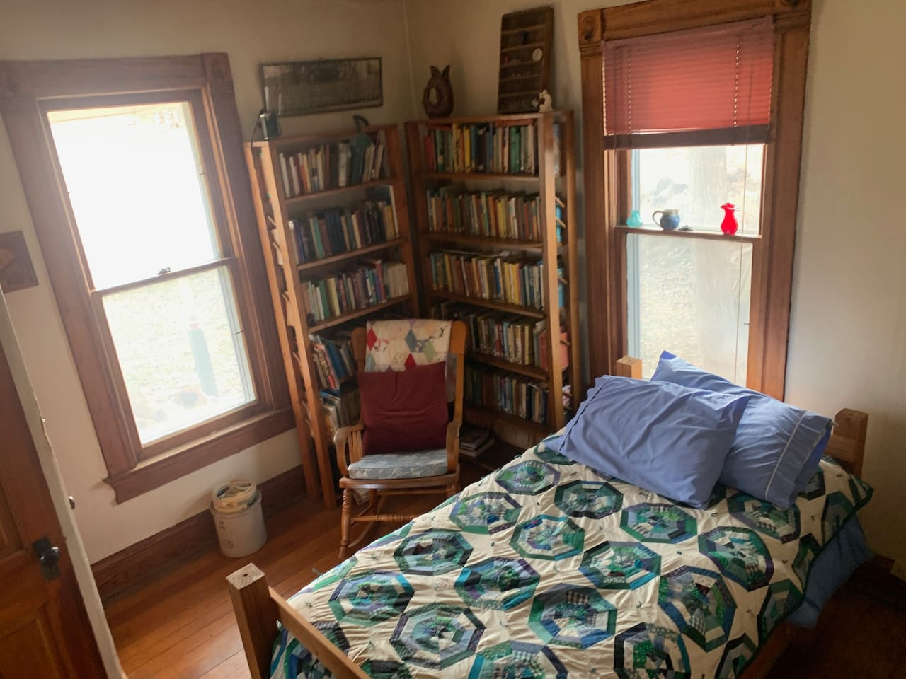 Single bed and rocking chair in farm house.