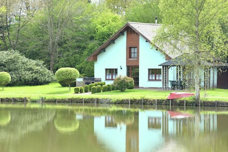 Quaint Chalet in Hannut with a Pond