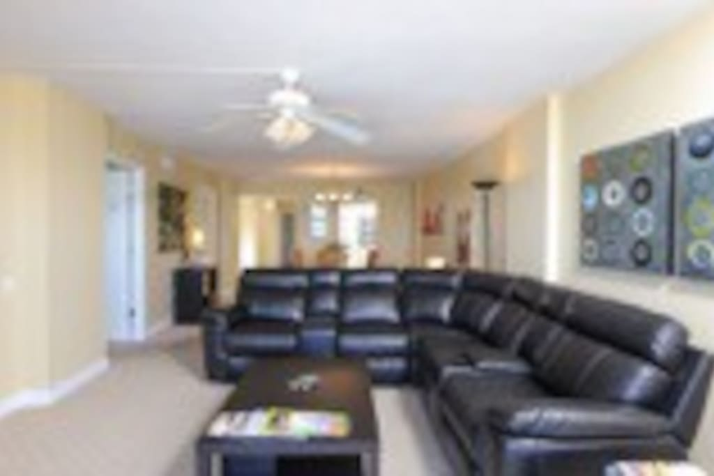 Livingroom and dining behind couch