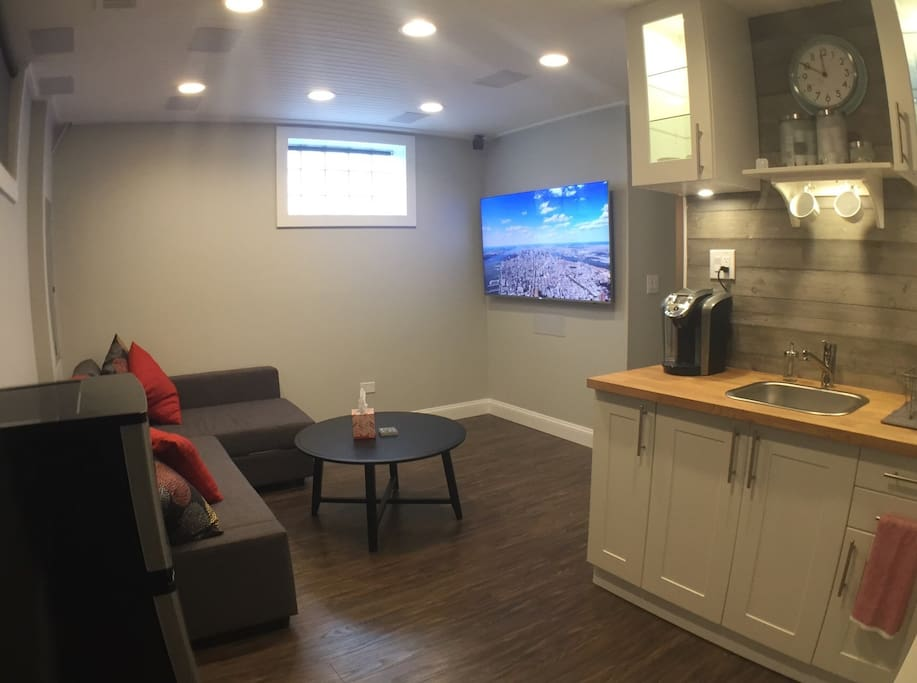 Suite living area with cable TV and kitchenette; Keurig and coffe/tea pods provided