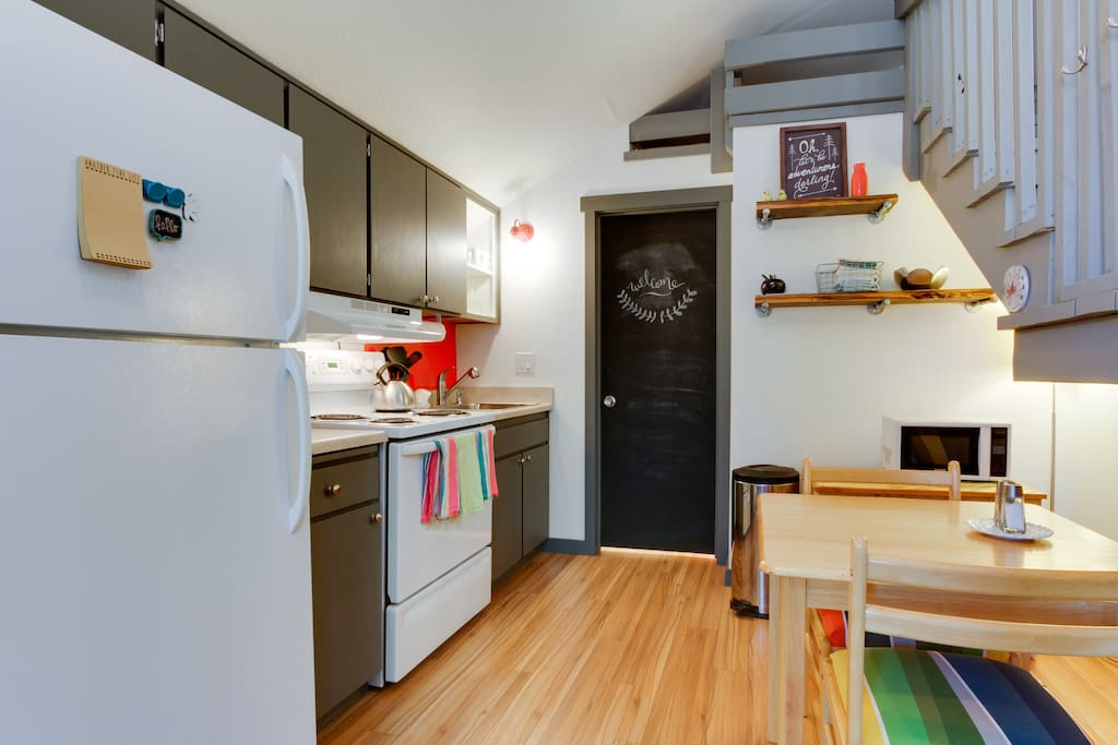 The kitchen has a full-sized refrigerator, stove, and sink. The ohana is stocked with everything you need to make a meal at home.  A chalkboard door is ready for your artistic creation!