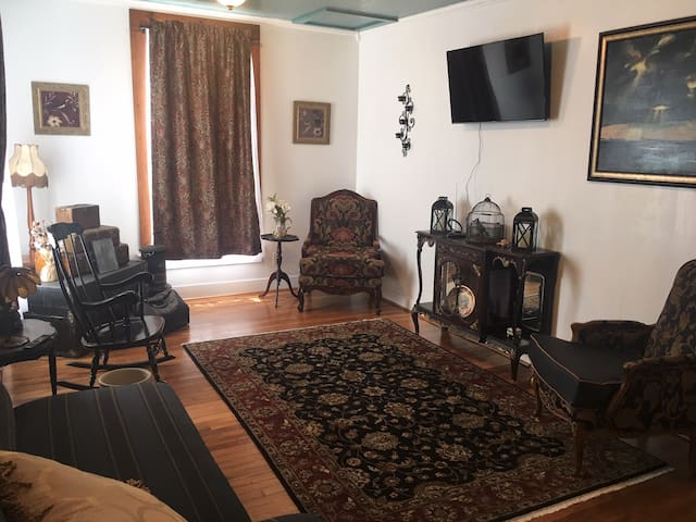 "Once climbing the stairs you will enter the living room known as ""JJ's room."" This room was one of the original 1850 hotel rooms. It was known to house numerous Traveling Salesman during their visits to Seguin."